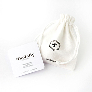 Toolally earrings cotton pouch